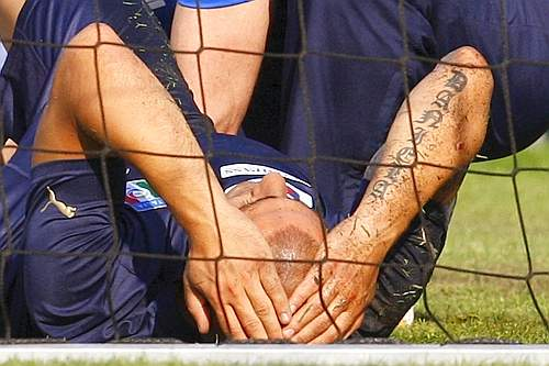 Italy's Cannavaro reacts after he was injured during a training session at the Suedstadt stadium in Maria Enzersdorf