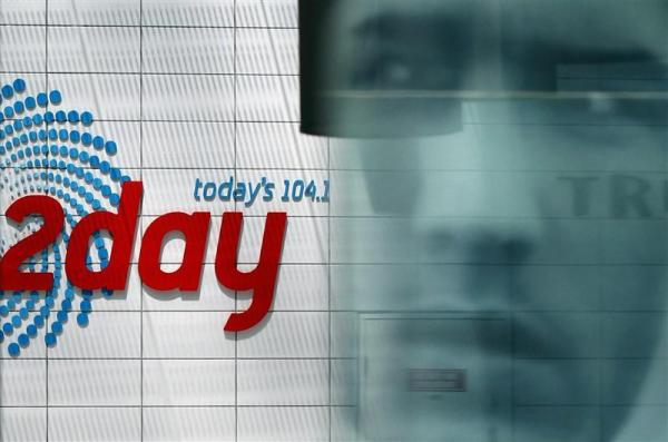 Advertisement is reflected at the entrance of the building that houses the 2Day FM radio station in Sydney