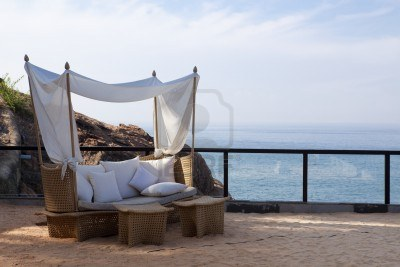9823695-deck-chair-by-the-sea-in-a-hotel-resort-in-kerala-state-india