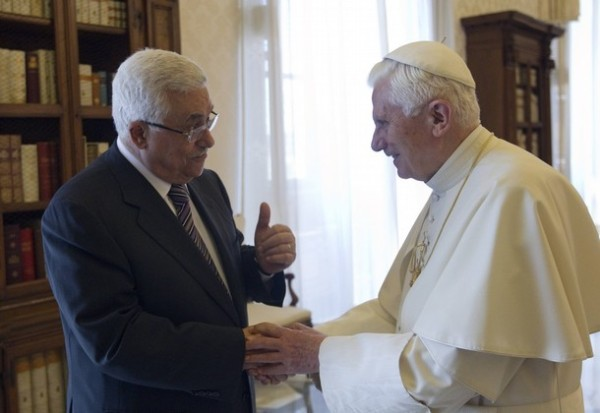 Pope Benedict XVI talks with Palestinian President Mahmoud Abbas during a meeting at the Vatican