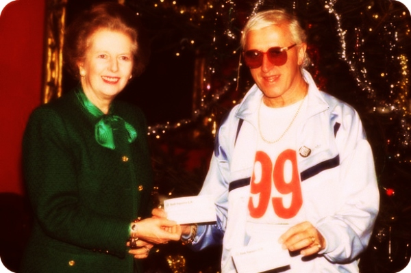 Jimmy+Savile+receives+a+cheque+from+Margaret+Thatcher