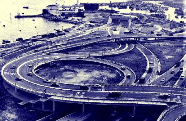 The Cross Harbour Tunnel - view of the tunnel entrance on Hong Kong side and the network of roads and flyovers, early 1970s